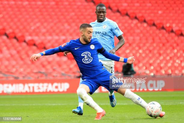 Chelsea's Moroccan midfielder Hakim Ziyech shoots to score the opening goal of the English FA Cup semi-final football match between Chelsea and...