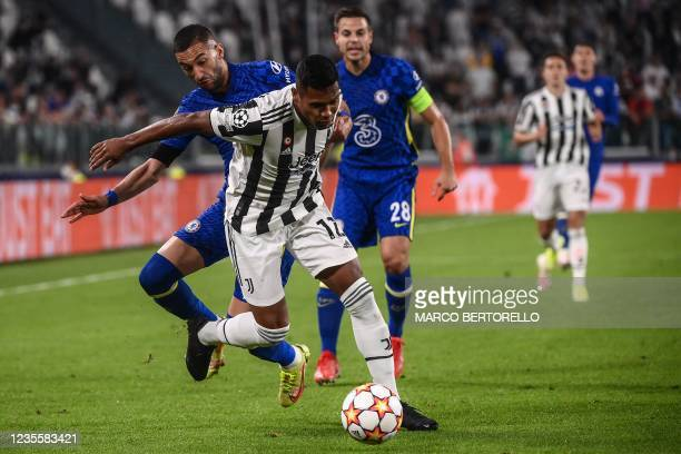 Chelsea's Moroccan midfielder Hakim Ziyech tackles Juventus' Brazilian defender Alex Sandro during the UEFA Champions League Group H football match...