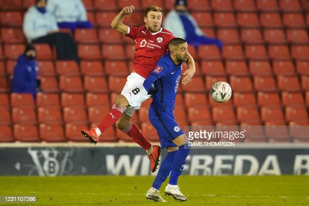 Chelsea's Moroccan midfielder Hakim Ziyech vies with Barnsley's English midfielder Herbie Kane during the English FA Cup fifth round football match...