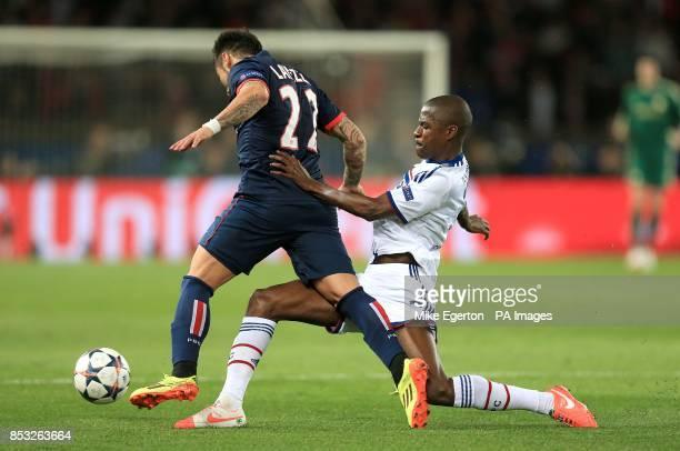 Chelsea's Nascimento Ramires brings down PSG's Ezequiel Lavezzi as they battle for the ball