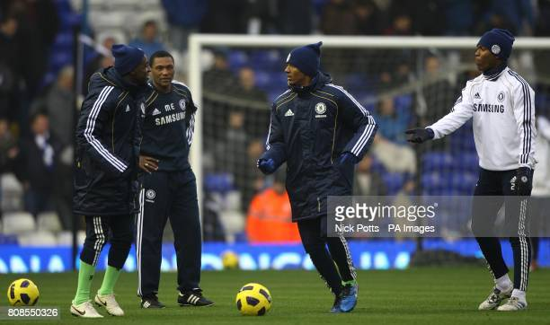 Chelsea's new assistant first team coach Michael Emenalo watches his players warm up prior to kick off