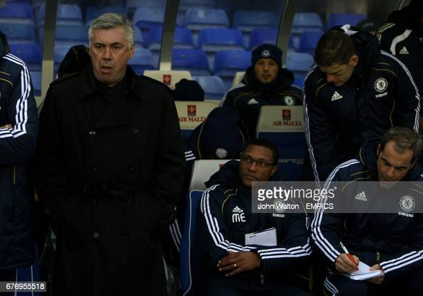 Chelsea's new assistant manager Michael Emenalo looks up at their manager Carlo Ancelotti