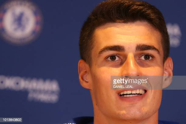 Chelsea's new goalkeeper Spain's Kepa Arrizabalaga gestures as he attends his unveiling press conference at Stamford Bridge in west London on August...
