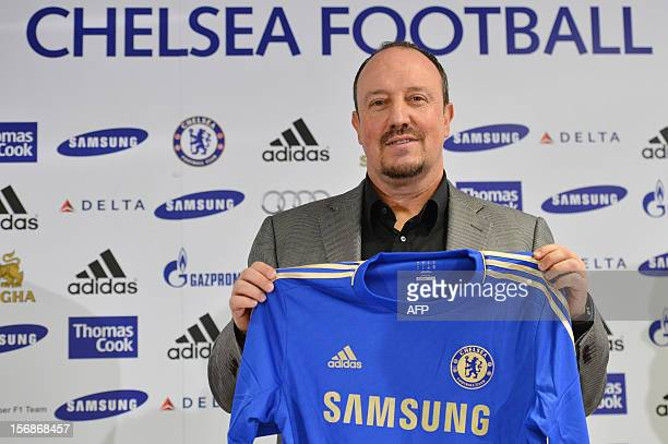 Chelsea's new interim manager Spain's Rafael Benitez holds up a Chelsea jersey during a press conference at Stamford Bridge in London on November 22...