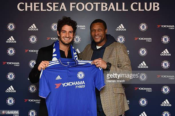 Chelsea's new signing Alexandre Pato signs for Chelsea FC and holds the home shirt with technical director Michael Emenalo at the Cobham Training...