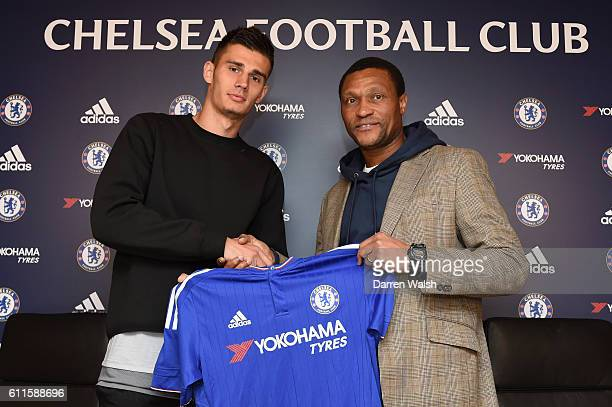 Chelsea's new signing Matt Miazga signs for Chelsea FC and holds the home shirt with technical director Michael Emenalo at the Cobham Training Ground...