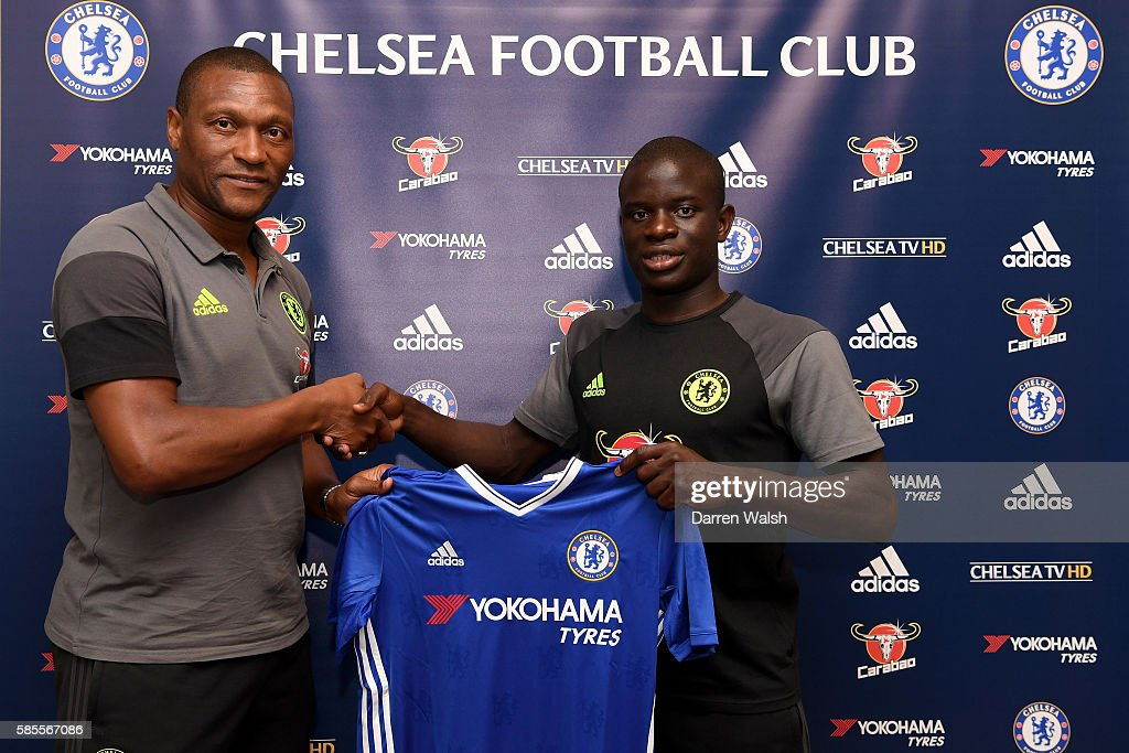Chelsea's new signing N'Golo Kante poses for a photo with technical director Michael Emenalo during the club's pre-season US tour at Loews Hotel on August 3, 2016 in Minneapolis, Minnesota.