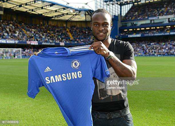 Chelsea's new signing Victor Moses holds up the club shirt before kick off