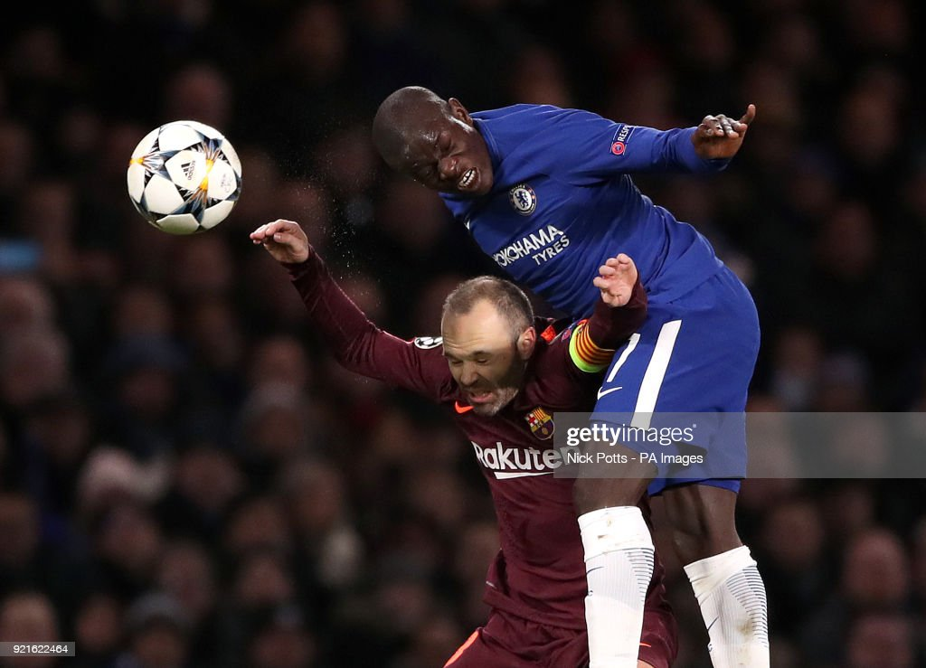 Chelsea's N'Golo Kante (right) and Barcelona's Andres Iniesta battle for the ball during the UEFA Champions League round of sixteen, first leg match at Stamford Bridge, London.