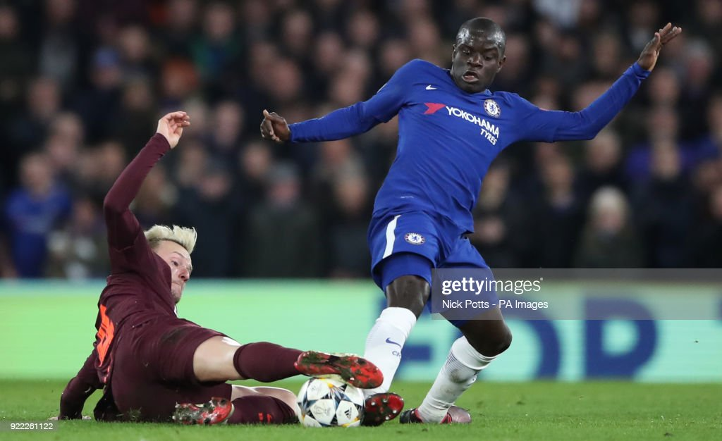 Chelsea's N'Golo Kante (right) and Barcelona's Ivan Rakitic battle for the ball during the UEFA Champions League round of sixteen, first leg match at Stamford Bridge, London. PRESS ASSOCIATION Photo. Picture date: Tuesday February 20, 2018. See PA story SOCCER Chelsea. Photo credit should read: Nick Potts/PA Wire