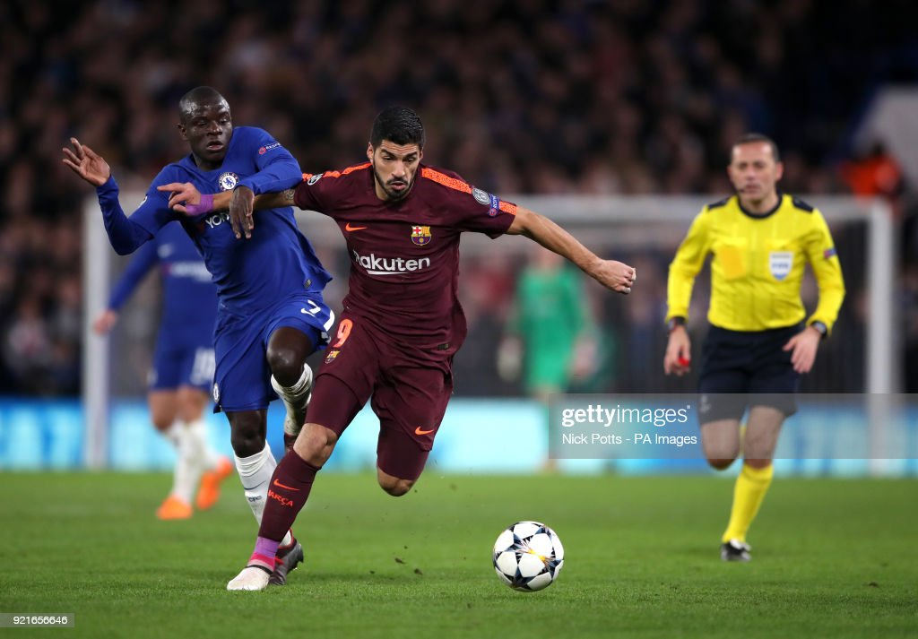 Chelsea's N'Golo Kante (left) and Barcelona's Luis Suarez battle for the ball during the UEFA Champions League round of sixteen, first leg match at Stamford Bridge, London.