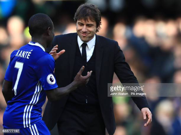 Chelsea's N'Golo Kante and Chelsea manager Antonio Conte after the final whistle during the Premier League match at Stamford Bridge London