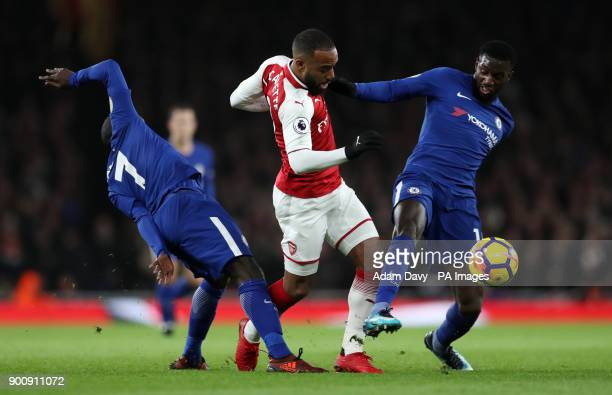 Chelsea's N'Golo Kante and Tiemoue Bakayoko challenge Arsenal's Alexandre Lacazette during the Premier League match at the Emirates Stadium London
