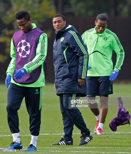 Chelsea's Nigerian first team assistant coach Michael Emenalo watches the players during a team training session at the club's training ground in...
