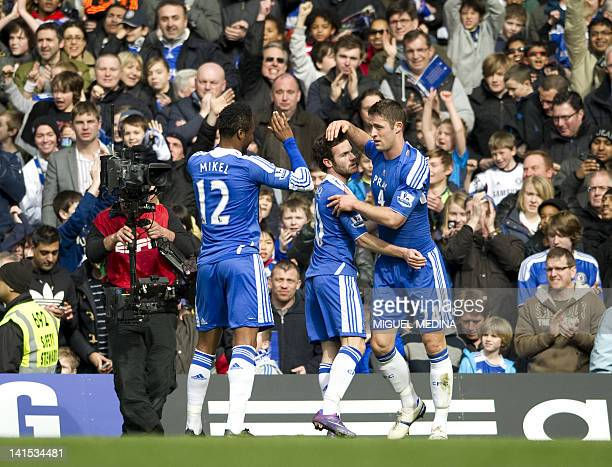 Chelsea's Nigerian midfielder John Mikel Obi and Chelsea's Spanish midfielder Juan Mata celebrates with Chelsea's English defender Gary Cahill after...