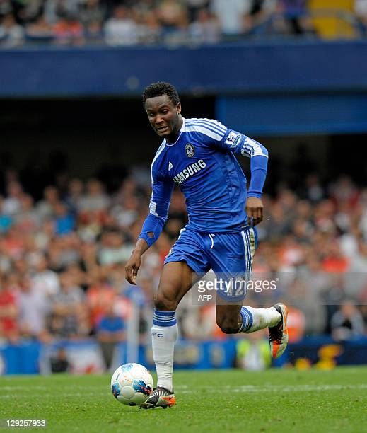 Chelsea's Nigerian midfielder John Mikel Obi in action during the English Premier League football match between Chelsea and Swansea City at Stamford...