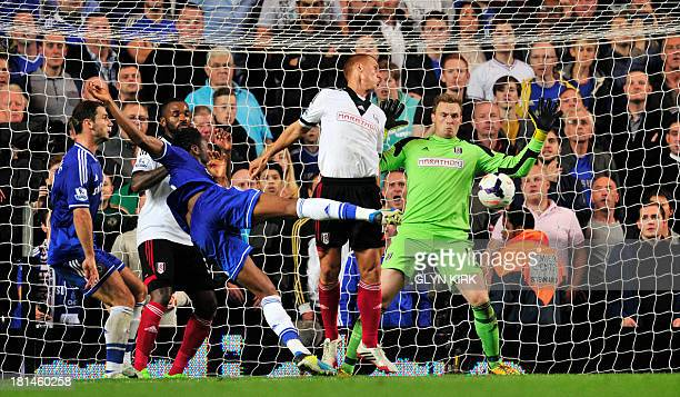 Chelsea's Nigerian midfielder John Mikel Obi scores his team's second goal during the English Premier League football match between Chelsea and...
