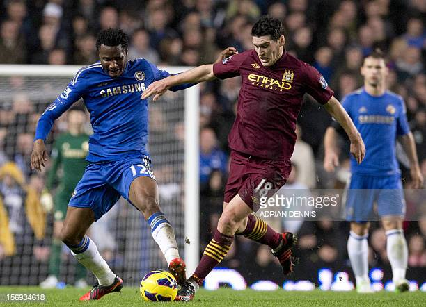 Chelsea's Nigerian midfielder John Mikel Obi vies for the ball against Manchester City's English midfielder Gareth Barry during the English Premier...