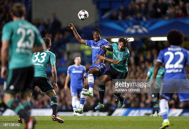 Chelsea's Nigerian midfielder John Mikel Obi vies for the ball against Schalke's US midfielder Jermaine Jones during the UEFA Champions League group...