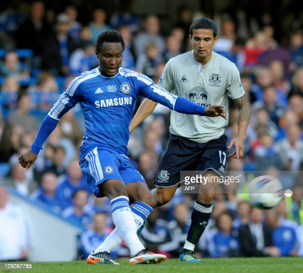 Chelsea's Nigerian midfielder John Mikel Obi vies with Everton's Australian midfielder Tim Cahill during the English Premier League football match...