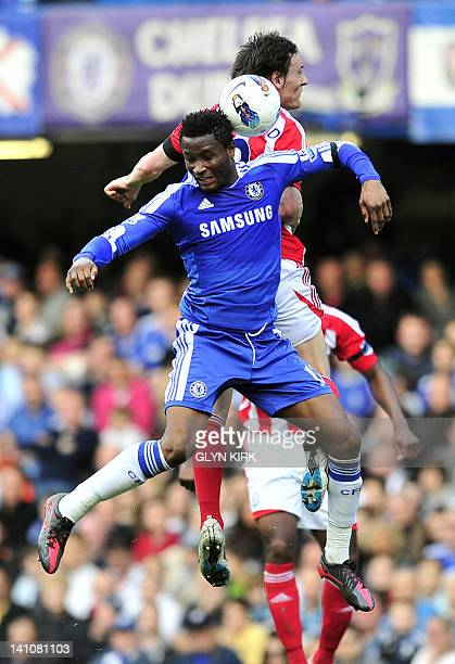 Chelsea's Nigerian midfielder John Mikel Obi vies with Stoke City's English midfielder Dean Whitehead during the English Premier League football...