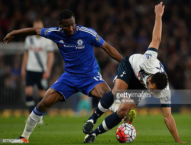 Chelsea's Nigerian midfielder John Obi Mikel battles with Tottenham Hotspur's Belgian midfielder Mousa Dembele during the English Premier League...