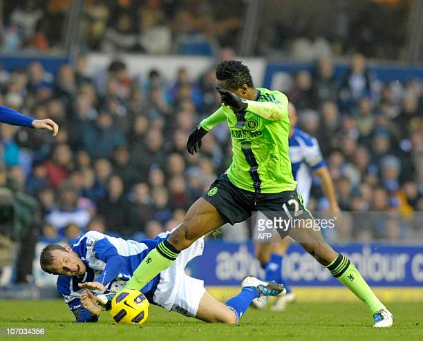 Chelsea's Nigerian midfielder John Obi Mikel vies with Birmingham City's English midfielder Lee Bowyer during the English Premier League football...