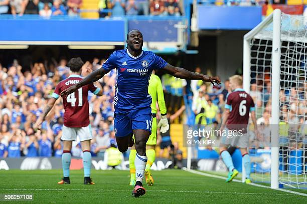 Chelsea's Nigerian midfielder Victor Moses celebrates after scoring during the English Premier League football match between Chelsea and Burnley at...