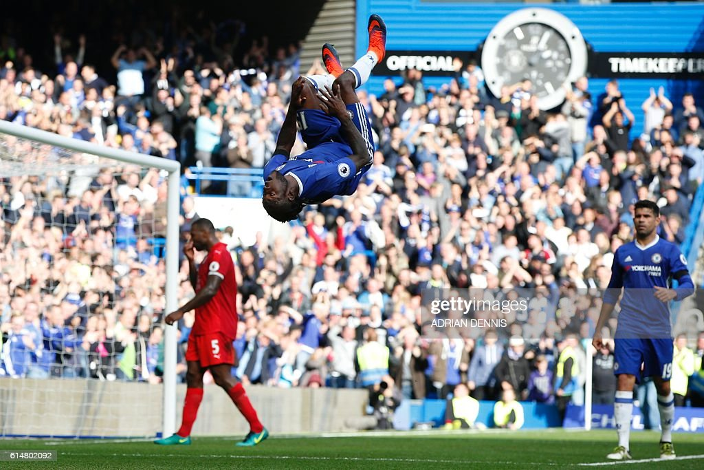 Chelsea's Nigerian midfielder Victor Moses (C) celebrates after scoring their third goal during the English Premier League football match between Chelsea and Leicester City at Stamford Bridge in London on October 15, 2016. / AFP / Adrian DENNIS / RESTRICTED TO EDITORIAL USE. No use with unauthorized audio, video, data, fixture lists, club/league logos or 'live' services. Online in-match use limited to 75 images, no video emulation. No use in betting, games or single club/league/player publications. /