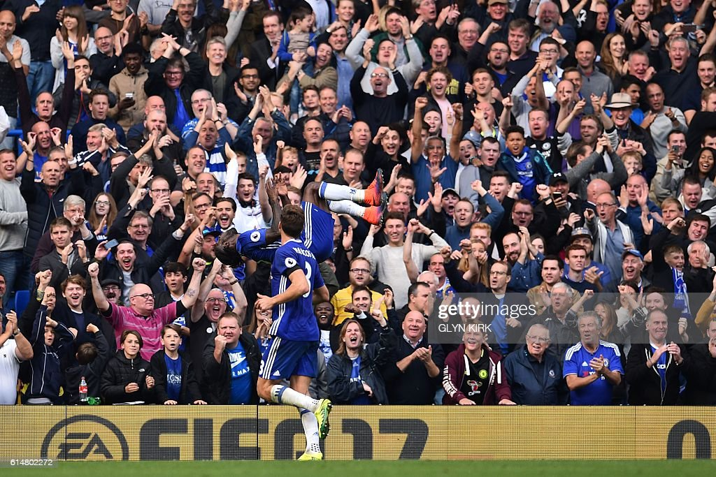 Chelsea's Nigerian midfielder Victor Moses (C) celebrates after scoring their third goal during the English Premier League football match between Chelsea and Leicester City at Stamford Bridge in London on October 15, 2016. / AFP / Glyn KIRK / RESTRICTED TO EDITORIAL USE. No use with unauthorized audio, video, data, fixture lists, club/league logos or 'live' services. Online in-match use limited to 75 images, no video emulation. No use in betting, games or single club/league/player publications. /