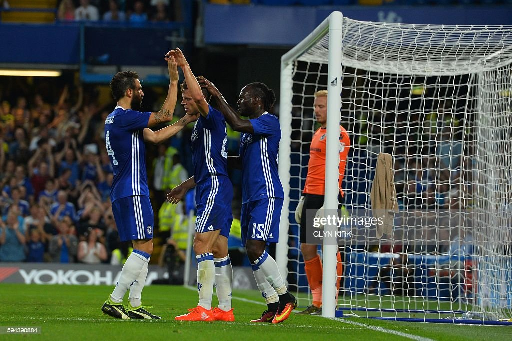 Chelsea's Nigerian midfielder Victor Moses (R) celebrates with Chelsea's Spanish defender Cesar Azpilicueta (C) and Chelsea's Spanish midfielder Cesc Fabregas (L) after scoring their second goal during the English League Cup second round football match between Chelsea and Bristol Rovers at Stamford Bridge in London on August 23, 2016. / AFP / GLYN KIRK / RESTRICTED TO EDITORIAL USE. No use with unauthorized audio, video, data, fixture lists, club/league logos or 'live' services. Online in-match use limited to 75 images, no video emulation. No use in betting, games or single club/league/player publications. /