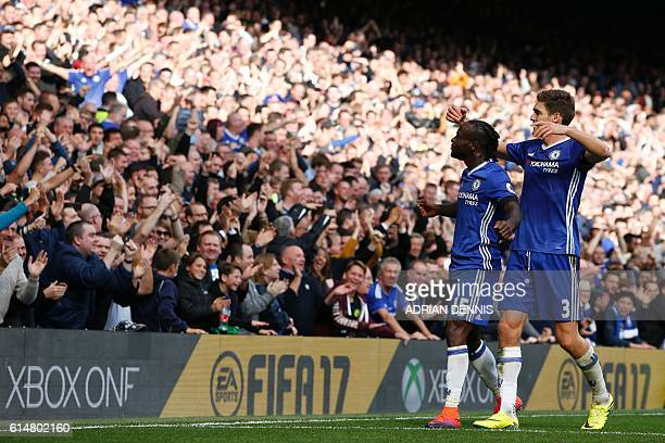 Chelsea's Nigerian midfielder Victor Moses celebrates with Chelsea's Spanish defender Marcos Alonso after scoring their third goal during the English...