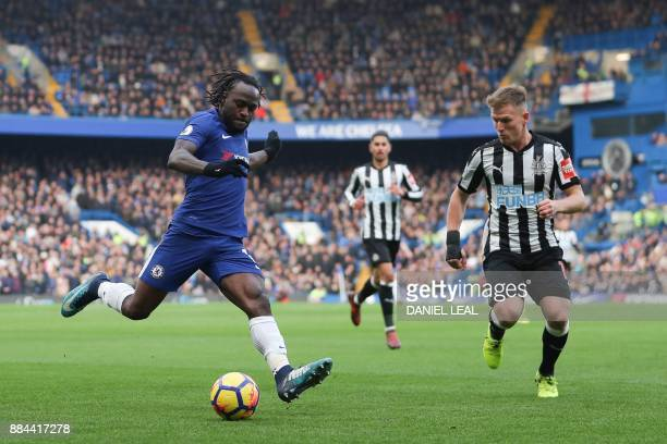 Chelsea's Nigerian midfielder Victor Moses crosses the ball opposed by Newcastle United's Scottish midfielder Matt Ritchie during the English Premier...