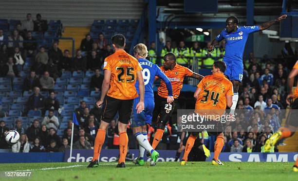Chelsea's Nigerian midfielder Victor Moses scores against Wolverhampton Wanderers during the third round English League Cup football match football...