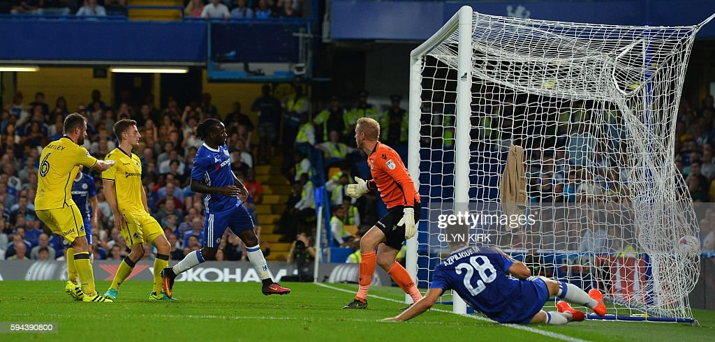 Chelsea's Nigerian midfielder Victor Moses (C) scores their second goal during the English League Cup second round football match between Chelsea and Bristol Rovers at Stamford Bridge in London on August 23, 2016. / AFP / GLYN KIRK / RESTRICTED TO EDITORIAL USE. No use with unauthorized audio, video, data, fixture lists, club/league logos or 'live' services. Online in-match use limited to 75 images, no video emulation. No use in betting, games or single club/league/player publications. /