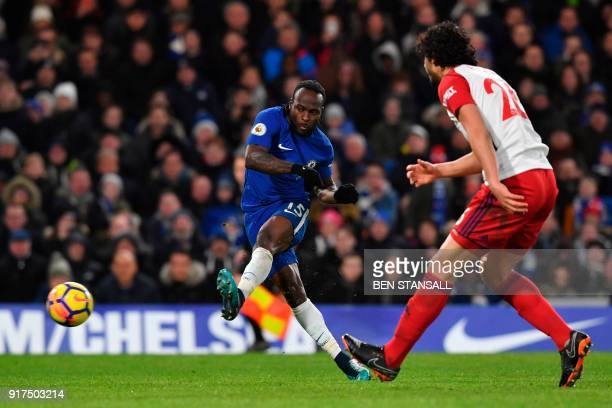 Chelsea's Nigerian midfielder Victor Moses scores their second goal during the English Premier League football match between Chelsea and West...