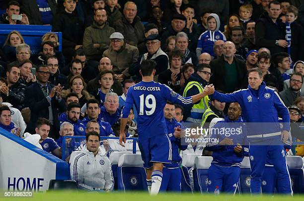 Chelsea's Nigerian technical director Michael Emenalo applauds as Chelsea's Brazilianborn Spanish striker Diego Costa is substituted during the...
