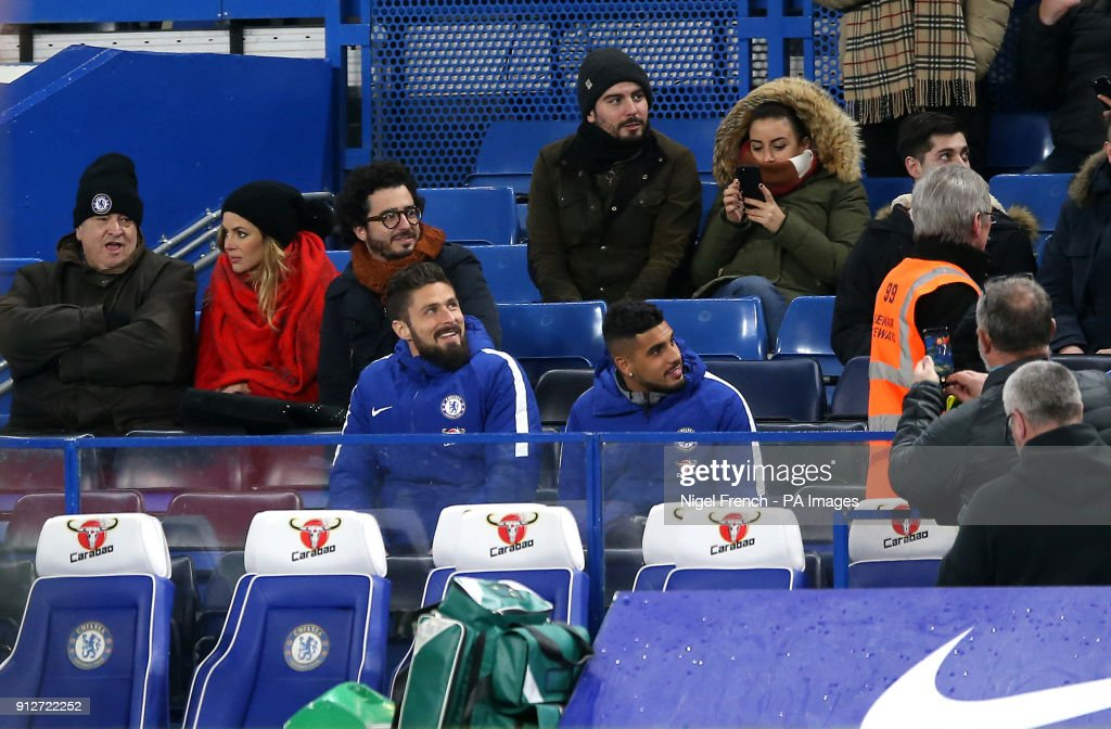Chelsea's Olivier Giroud (left) and Emerson Palmieri (right) in the stands during the Premier League match at Stamford Bridge, London.