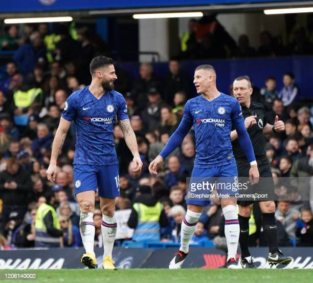 Chelsea's Olivier Giroud and Ross Barkley celebrate their sides third goal during the Premier League match between Chelsea FC and Everton FC at...