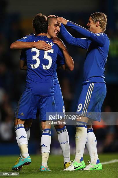 Chelsea's Oriol Romeu celebrates scoring their forth goal of the match with teammates Lucas Piazon and Fernando Torres during the Capital One Cup...