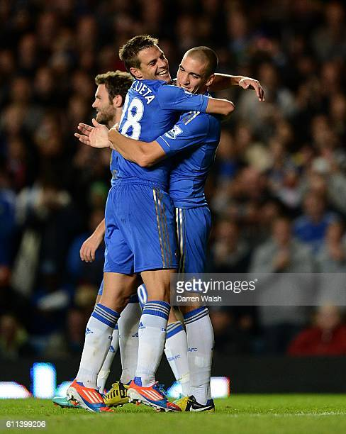 Chelsea's Oriol Romeu celebrates with his teammates after scoring his side's fourth goal from the penalty spot