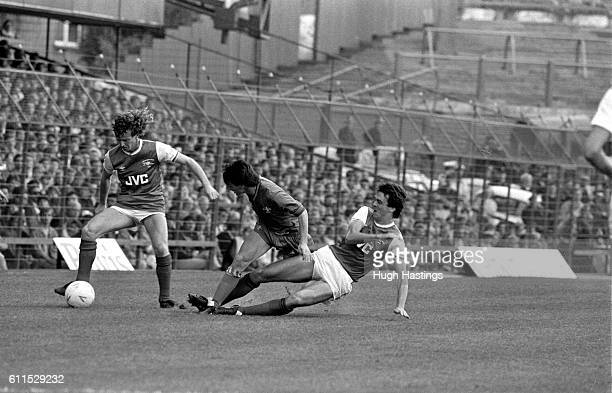 Chelsea's Pat Nevin tussles with Graham Rix and David O'Leary of Arsenal
