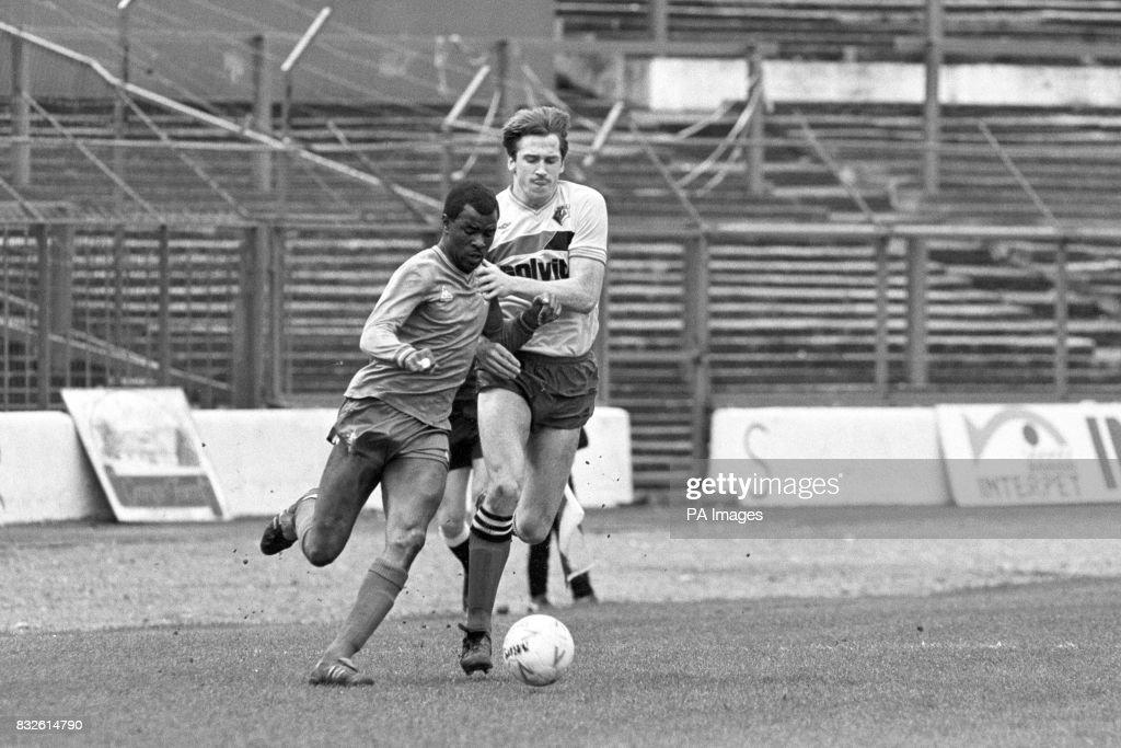 Chelsea's Paul Canoville (l) gets past Watford's John McClelland