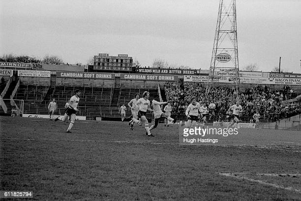 Chelsea's Paul Canoville leads an attack on the Bolton goal