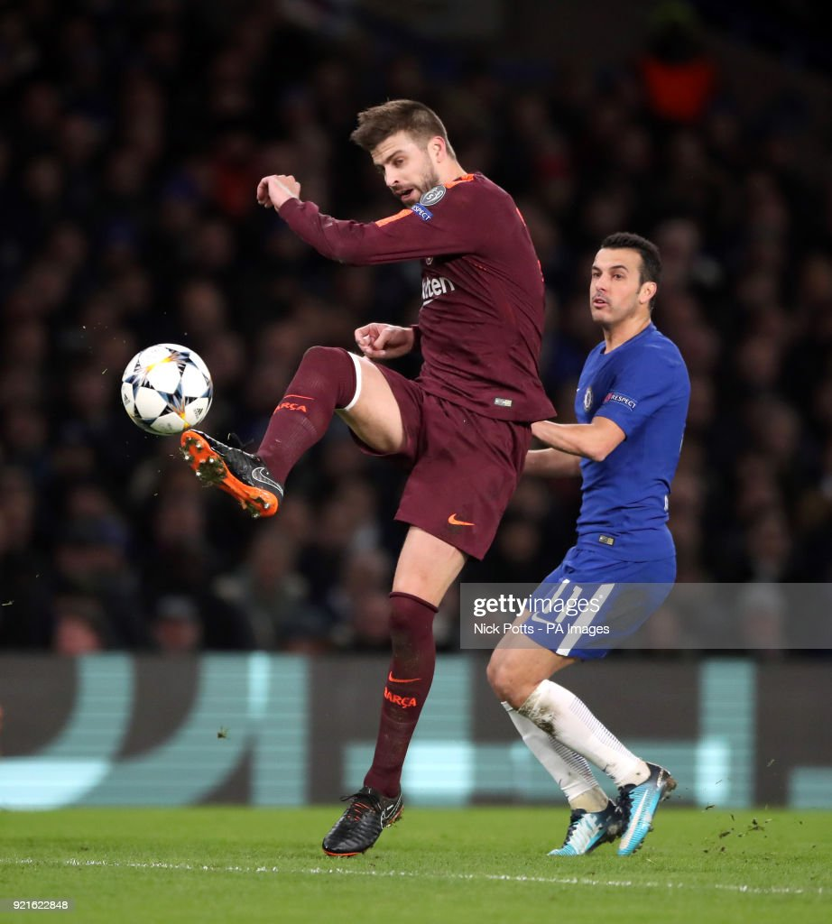 Chelsea's Pedro (right) and Barcelona's Gerard Pique battle for the ball during the UEFA Champions League round of sixteen, first leg match at Stamford Bridge, London.