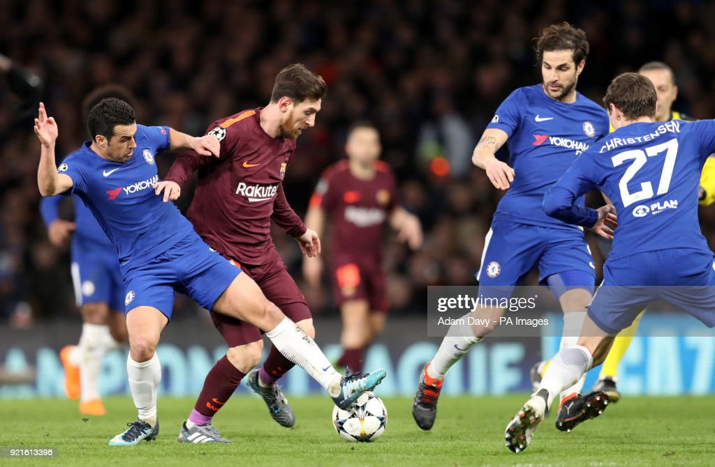 Chelsea's Pedro (left) and Barcelona's Lionel Messi battle for the ball during the UEFA Champions League round of sixteen, first leg match at Stamford Bridge, London.
