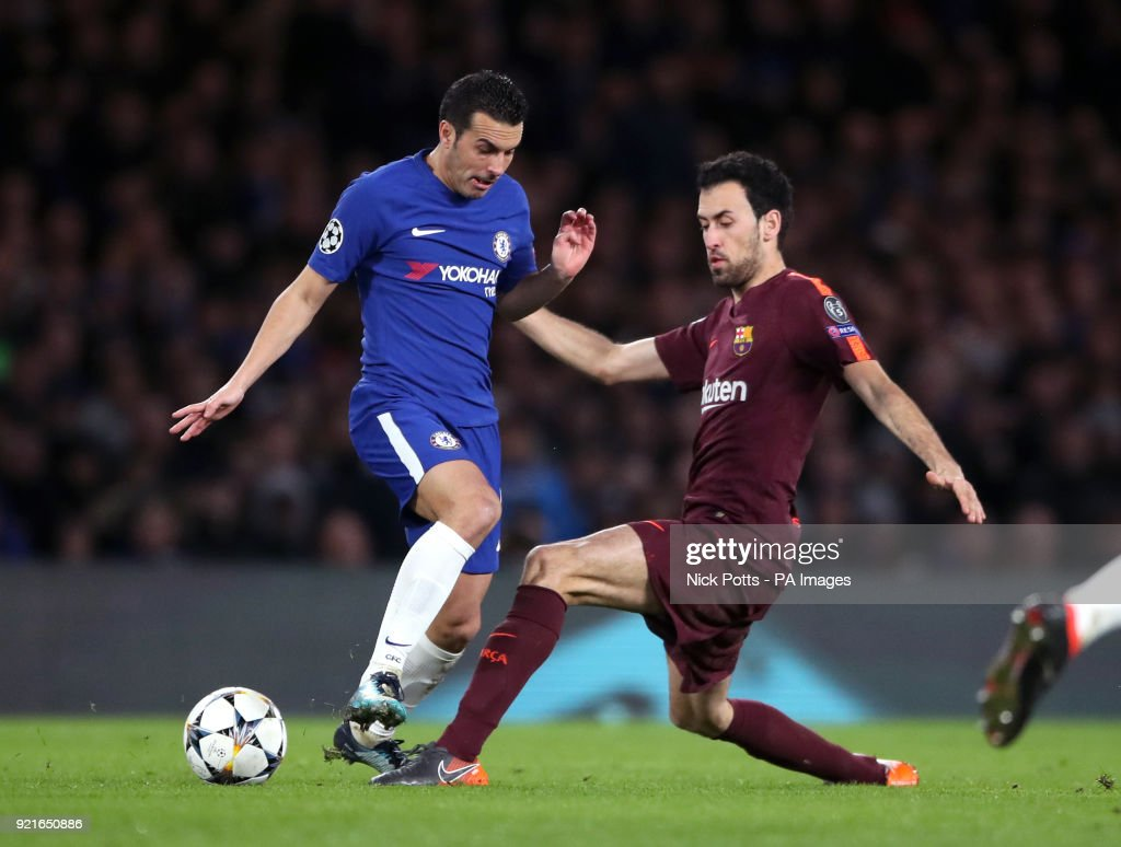 Chelsea's Pedro (left) and Barcelona's Sergio Busquets battle for the ball during the UEFA Champions League round of sixteen, first leg match at Stamford Bridge, London.
