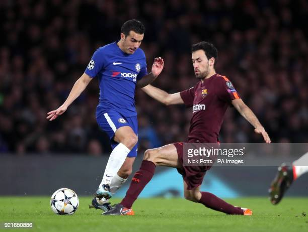 Chelsea's Pedro and Barcelona's Sergio Busquets battle for the ball during the UEFA Champions League round of sixteen first leg match at Stamford...