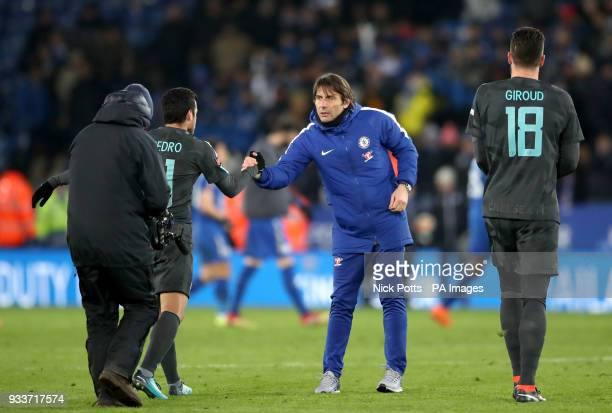 Chelsea's Pedro and manager Antonio Conte after the final whistle of the Emirates FA Cup quarter final match at the King Power Stadium Leicester