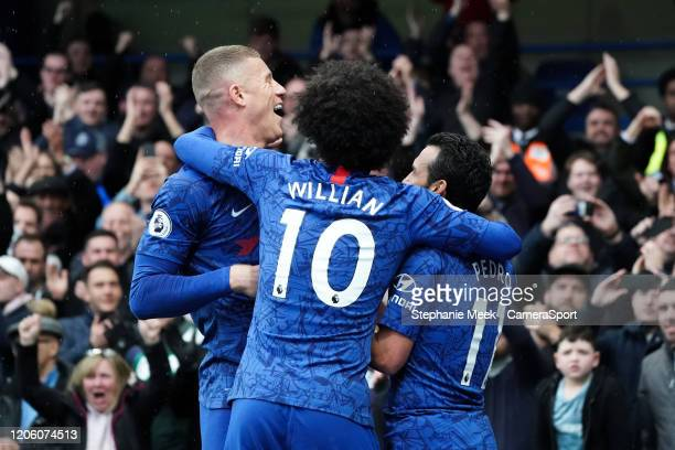 Chelsea's Pedro celebrates scoring his side's second goal with team-mates Willian, Ross Barkley during the Premier League match between Chelsea FC...